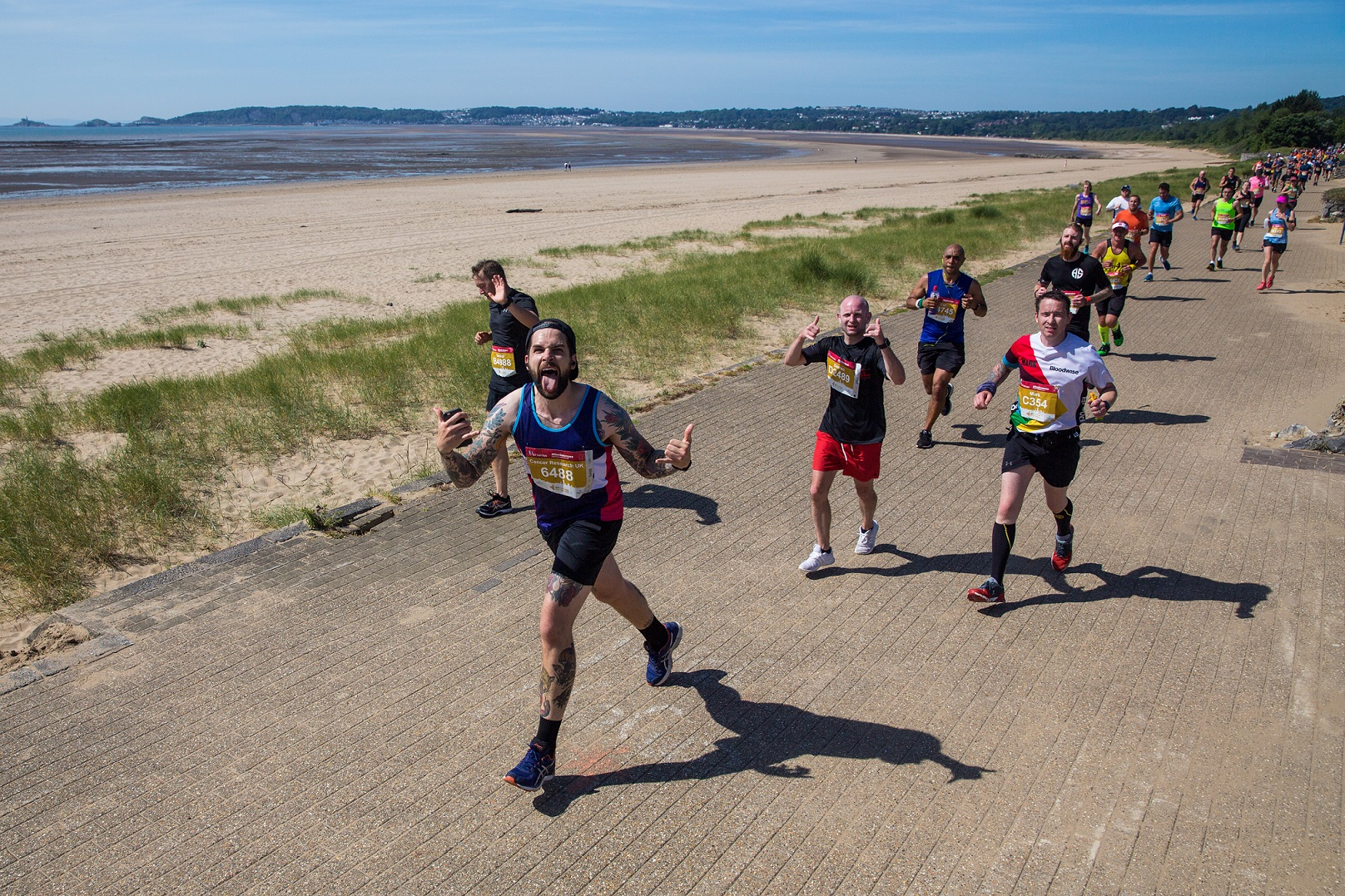 Longest Standing Charity Cancer Research UK  Offers Up Places at the JCP Swansea Half Marathon